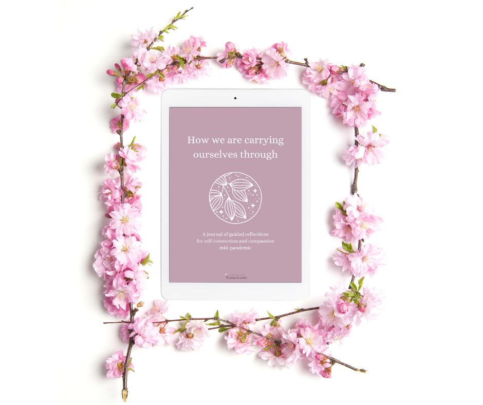 Tablet showing cover of journal surrounded by cherry blossoms